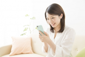 47028288 - women have a smart phone and smile